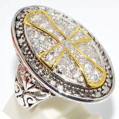 Anel de cruz ladeada por topázios, banhada a ouro 24 k - uma peça imponente e única.