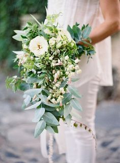 The bridal bouquet will be a cascading bouquet of silver dollar eucalyptus, jasmine vine, maidenhair ferns, white scabiosa, and Queen Anne's lace wrapped in TBD ribbon with the stems showing.