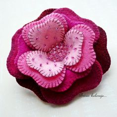 Beautiful flower with beads that really compliment the design.