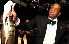 Jay-Z ft. a hundred thousand dollar bottle of champagne.