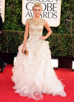 Julianne Hough looked like a punk rock princess in a white tulle and gold embroidered Monique Lhuillier gown at the Golden Globes 2013