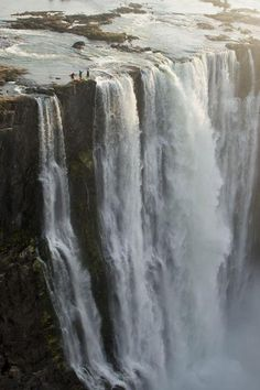 Victoria falls, Zimbabwe. Look closely -in the left third of the photo there are 3 teeny tiny people!!