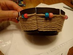 weaving bowl with styrofoam bowl, yarn, and beads
