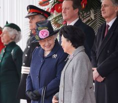 The Queen with Mrs Mary Tan, the wife of the President of the Republic of Singapore, during the State Visit ceremonial welcome, 21 October 2014. © Press Association