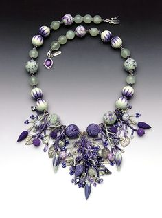 Pat Bolgar - Necklace of polymer clay beads and seed bead berries on fringe.