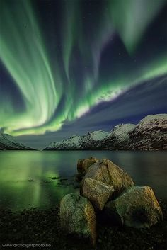 """Fjord of Light""    Arctic Light Photo - Ole Salomonsen Photography    Shot this last night nov.20th in Ersfjord, a 20min drive from Tromsø, northern Norway.    Last night the sky was filled with strong auroras, and even if this shot was far from the one with the strongest auroras I choose to post this one as I liked to overall feeling to it."