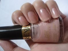 Revlon Sheer Rose :: A sheer rose w/ buildable opacity. A nude-rosey color w/ a very subtle hint of microglitter/shimmer. Lasts a good week w/o base or top coat :: I dropped my last bottle (I had 2) on my bathroom's tile floor & it went all over the place. It was my favorite nude shade & now I can't find it! GRR!! | #revlonnailpolish #nudenailpolish #sheernailpolish