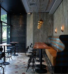 Matto Bar & Pizzeria in Shanghai designed by Pure Creative International. I love the mix of patterns, textures, and raw materials with the more designed elements - the tin ceiling is a surprise.