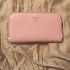 Prada wallet Gently used soft pink Prada wallet. Missing the zipper toggle but the zipper still works perfectly fine. Will take offers it was a gift from an ex so trying to get rid of it. Prada Bags Wallets