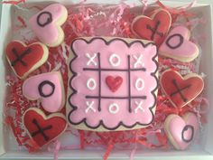Love is in the air with this Valentines Day gift set. Each box includes 9 cookies decorated with delicious royal icing.    This order is for 1