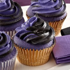 Score big on Baltimore game day with purple and black frosted cupcakes.