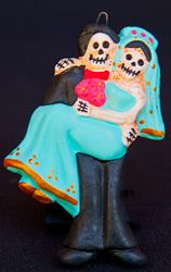 skelton groom holding bride ornament