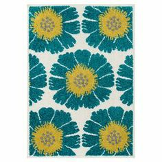 Indoor/outdoor rug with a floral motif.   Product: RugConstruction Material: PolypropyleneColor: Blue, ivory and yellowFeatures:  Suitable for indoor or outdoor useMade in Egypt Note: Please be aware that actual colors may vary from those shown on your screen. Accent rugs may also not show the entire pattern that the corresponding area rugs have.