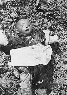 The inocent victims of war.a child left to rot on the battle field. Dead Chinese child in Nanjing, China, Dec