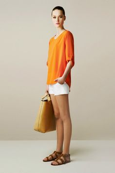 i loooove orange and white together and how flowy this top is