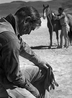 Clark Gable on the set of The Misfits (1961, dir. John Huston) (via)  Photographer: Eve Arnold