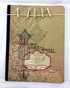 Beautiful embellished composition journal.  Love the clothes pins for notes and ticket stubs!