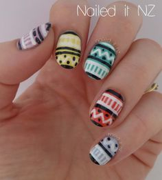 Black and white tribal design on colored nails.  Could be fun with a variety of different colored bases for different seasons.