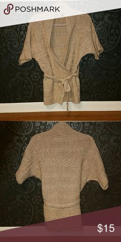 Cream Colored Open Front Cardigan This super soft open front cardigan from The Limited includes a matching wrap belt.  Elbow length sleeves with beautiful cable knit details and a shawl colar.  Can be worn with or without the belt or paired with a contrasting belt.  Great for a work wardrobe or casual outfits.  Layer and wear with dress slacks, jeans, skirts, or even dresses.  Worn only once. The Limited Sweaters Cardigans