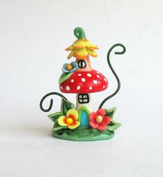 This miniature whimsy toadstool mushroom house is a one of a kind original design and creation by artist C. Rohal. It is completely hand made,