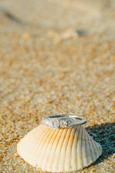 Kyle+Alex: Engaged Photo By Nathan Gilmer Photography engagement photo beach shot ormond beach FL engagement ring