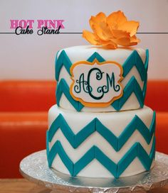 Orange and turquoise chevron 2 tier birthday cake with hand-painted monogram monogram chevron cake, birthdays, 2 tier birthday cake, monogrammed birthday cakes, turquois chevron, orange and turquoise birthday, chevron birthday cake, turquoise birthday cake, tiered birthday cake