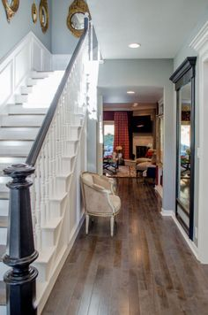 Beautiful use of mirrors and light colors in the hallway. #DreamBuilders