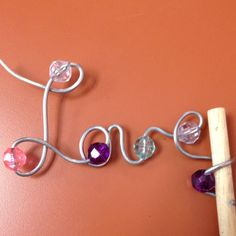 Craft wire garden stake. Super easy, add bling as you flex the wire!