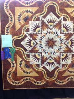 Glacier Star designed by Quiltworx.com, made by Linda Mathis with support from Certified Instructor Eileen Urbanak.  This quilt won First Place, Mayor's Choice, Members' Choice, and Machine Quilting Merit Ribbon.