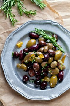 Recipe for Garlic, Thyme, and Rosemary Marinated Olives. Perfect for simple holiday entertaining!