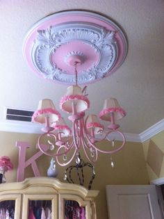 Chandelier and Ceiling Medallion - I found this both at a garage sale ($10 for the ceiling medallion and $3 for the chandelier). I re-purposed the once bronze pair with pink paint and white trim. I then added pink coordinating trim to the shades and attached the chandelier crystals to give it a little bit of glam!