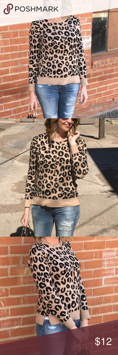 Animal print pullover sweater Leopard print sweater. Crew neck with side slits. Fit is a little small so I sized up one from my normal size of a small. This is a medium. So I would say this fits more like a small.  Target A New Day brand Sweaters Crew & Scoop Necks