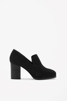 These shoes are made from panels of softly structured suede with a smooth leather underside. A round-toed style, they have a stacked block heel and comfortable leather insole.