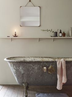 The Bilton Bathroom Mirror (£186), available in three finishes, hangs above the bath.