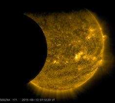 13, 2015 the moon, left, and the Earth, top, transiting the sun together, seen from the Solar Dynamics Observatory. The edge of Earth appears fuzzy because the atmosphere blocks different amounts of light at different altitudes. This image was taken in extreme ultraviolet wavelengths, invisible to human eyes, but here colorized in gold. A total lunar eclipse will share the stage with a so-called supermoon Sunday evening, Sept. 27, 2015 t been seen since 1982 happen again until 2033.