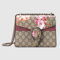 abe65971a1b Shop the Dionysus GG Blooms mini bag by Gucci. A mini structured bag with  our textured tiger head spur closure in Blooms print supreme canvas.