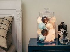 By putting the fairy lights in a jar, they become the perfect ornament to put on your mantle piece, bedside table, desk or dining table. The soft glow our lights emanate creates the ideal ambience for any room, and keeping them in jars transforms them into quirky lanterns. Even when the lights aren't switched on, the colourful cotton balls will still brighten up the room. Add a splash of colour to your life with our fantastic fairy lights. #Interiors #Decor