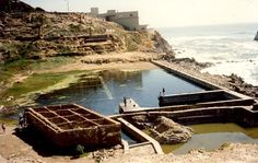 Sutro Bath ruins with Cliff House in background