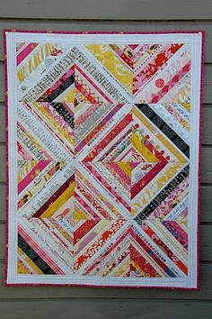 Pink & yellow selvage quilt