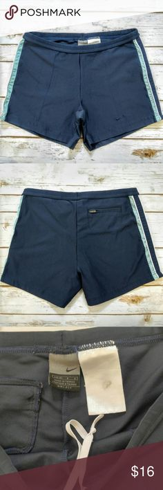 Nike Dri Fit Navy Athletic Shorts Nike Dri Fit Navy Athletic Shorts  Size L in good used condition. Zippered back pocket. Lots of stretch, very comfortable. Please let me know if you have any questions. I ship the same day as long as the post office is still open. Have a great day, thanks for checking out my closet and happy poshing! Nike Shorts