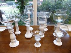 glass jars glued on the candlesticks for candy bar or groups of 3 for centerpieces
