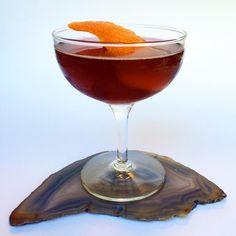 XXII. THE VIOLET TWILIGHT. Gin, dry vermouth, Campari, violet liqueur, orange twist.