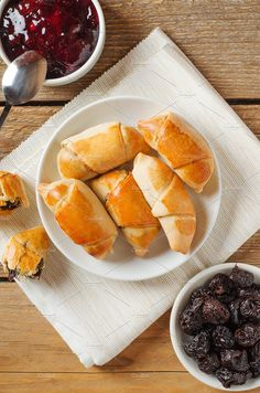 Sweet rolls with prunes on plate. by Mellisandra on @creativemarket