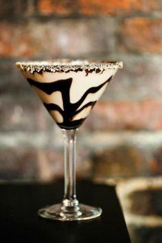 Tiramisu Martini: 1oz Frangelico, 1 oz Vodka (this recipe calls for Skyy), 1 oz Irish Cream, 1/2 oz cold expresso, drizzled chocolate syrup in glass and don't forget the rim!