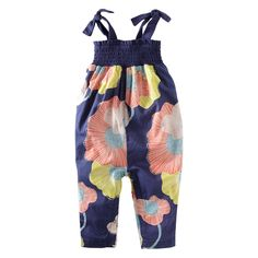 A softly bold bunch of surf lilies floated onto this cotton lawn romper with fun shoulder ties. it's an airy, breezy delight. With a gathered smocked jersey top. Two ties are definitely better than one. Imported.