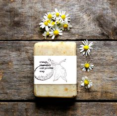 I like this image because the natural background with the wooden table and the daises helps to highlight that the soap is homemade. Soap Labels, Soap Packaging, Soap Display, Bulk Food, Homemade Soap Recipes, Up Book, Organic Soap, Thing 1, Cold Process Soap