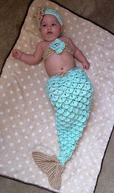 """This is a version """"2.0"""" of my original Mermaid Tail design. This pattern was designed for the baby sizes, please let me know if you'd like me to invest in designing larger sizes! The intent was primarily for baby photoshoots, but as a larger blanket anyone could be a mermaid if they wanted!"""
