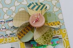 DIY: paperflower & button - good use of scrap paper bits