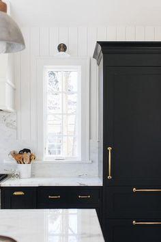 Black Shaker Cabinets with Polished Brass Vintage Pulls