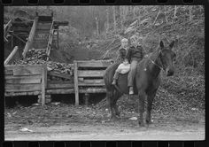 Returning home on muleback with a sack of meal. Knox County, KY, 1940. Library of Congress
